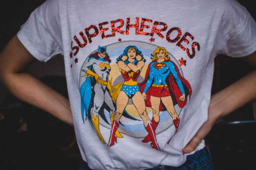 person wearing superheroes printed t shirt